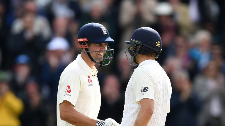 Alastair Cook celebrates with Dawid Malan after reaching his double century during day two at Edgbaston