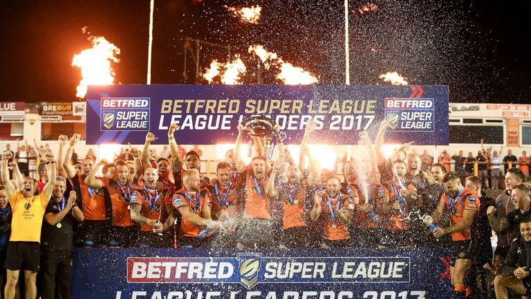 The Tigers celebrate lifting the League Leaders' Shield at the Mend-A-Hose-Jungle