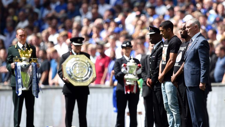 FA chairman Greg Clarke (right) and guests observe a minute's silence in memory of the Grenfell Tower victims before the Community Shield