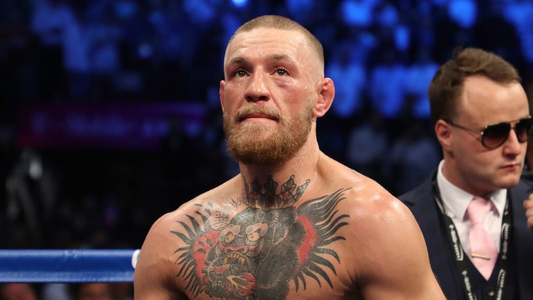 Conor McGregor's first ever professional boxing bout ended in a 10th round stoppage loss to Floyd Mayweather