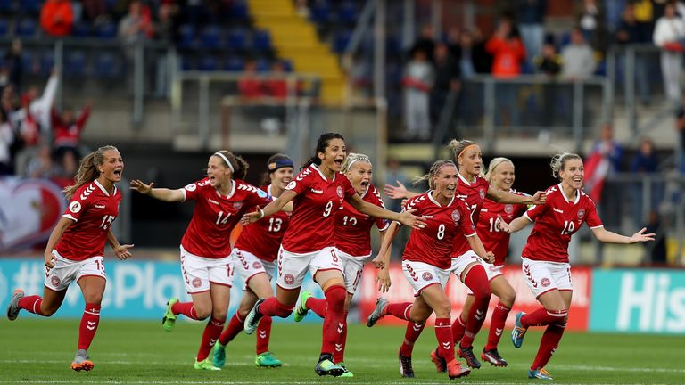 Denmark players celebrate their team's victory on penalties over Austria