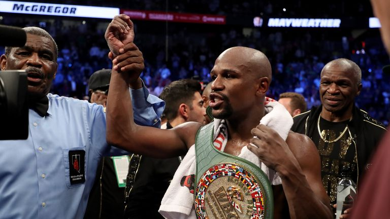 Floyd Mayweather moved to a record-breaking 50-0