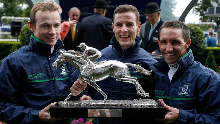 Jamie Spencer (L), Fran Berry (C) and Neil Callan lift the Shergar Cup for Great Britain & Ireland at Ascot