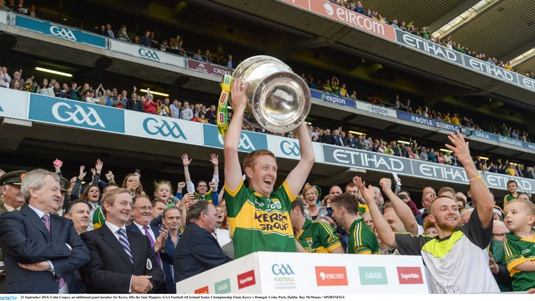 Colm Cooper, an additional panel member for Kerry, lifts the Sam Maguire. in 2014