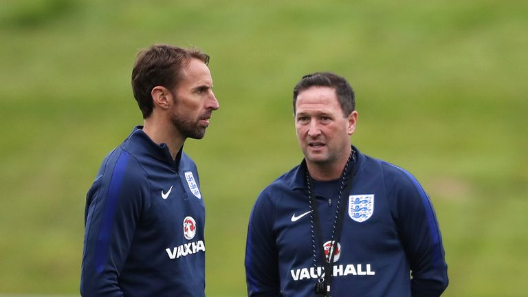 Gareth Southgate and his backroom team, including assistant Steve Holland (right),  prepare for Monday's opening game with Tunisia