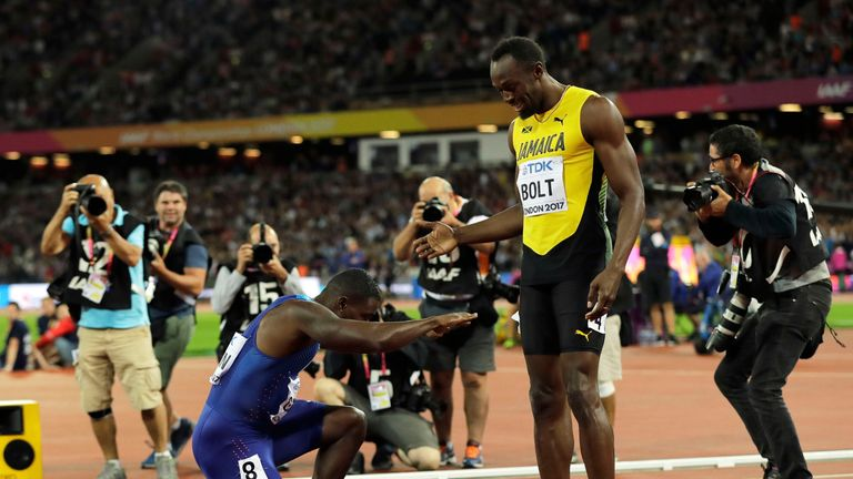 United States' Justin Gatlin bows to Usain Bolt after the Jamaican's final 100m run