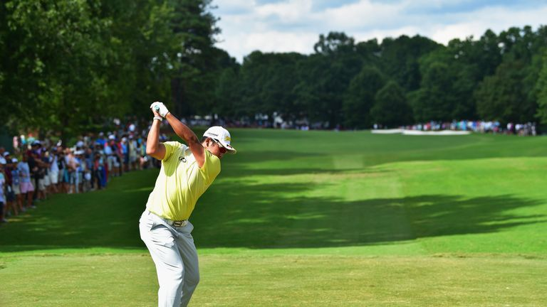 Matsuyama plays his shot from the ninth tee during the third round