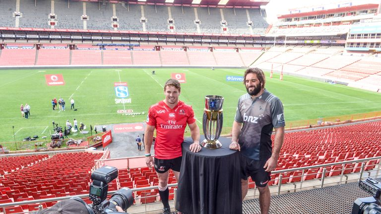 Lions captain Jaco Kriel (L) and Crusaders captain Sam Whitelock pose with the Super Rugby trophy