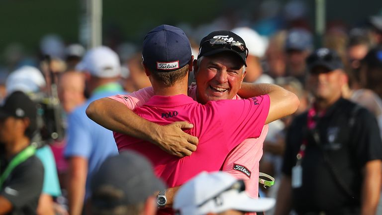 Thomas hugs his father Mike after clinching victory