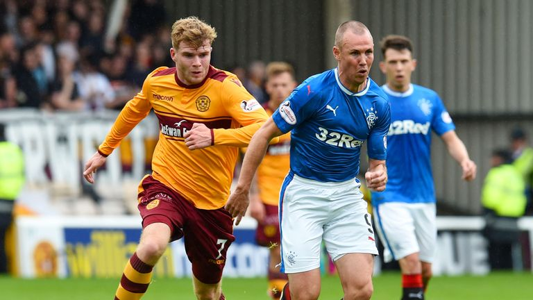 Rangers' Kenny Miller (right) is pursued by Motherwell's Chris Cadden