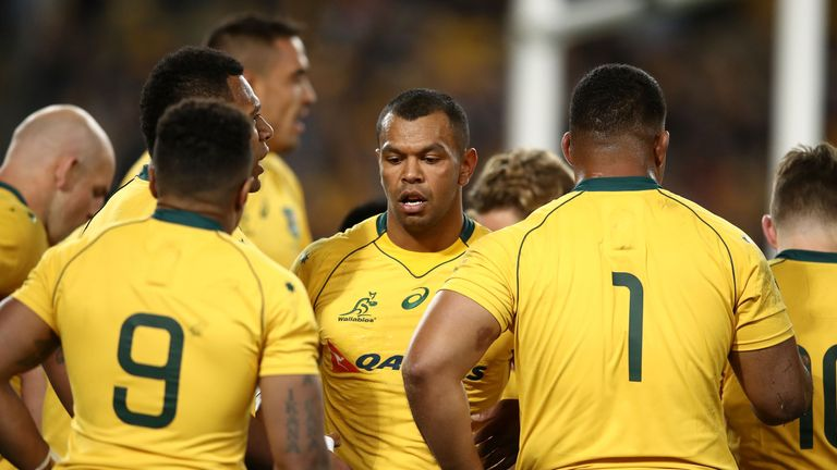 Kurtley Beale (centre) and Australia shipped eight tries on Saturday