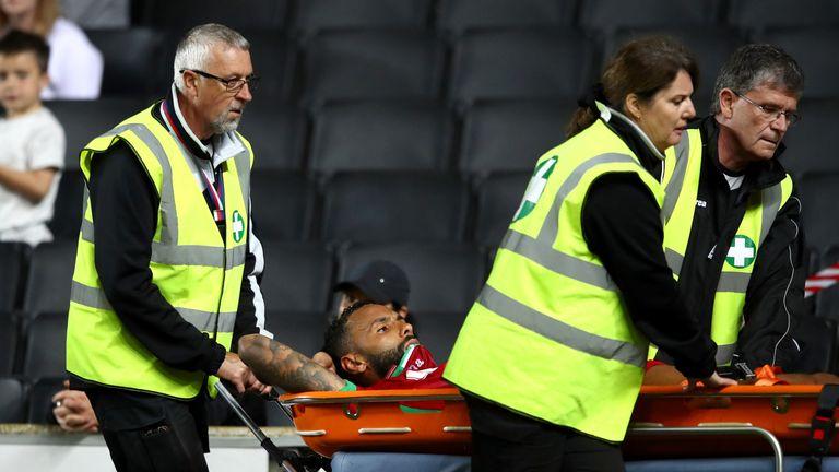 Swansea defender Kyle Bartley was taken off injured on a stretcher