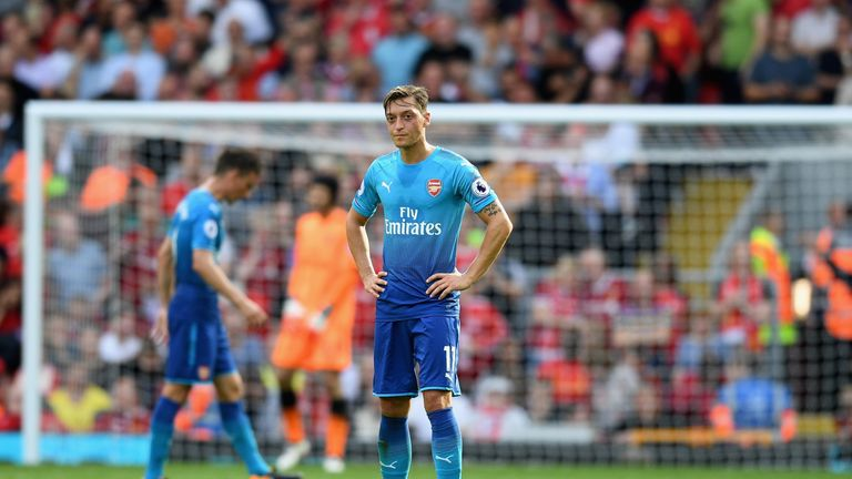 Mesut Ozil is dejected after Liverpool's fourth goal