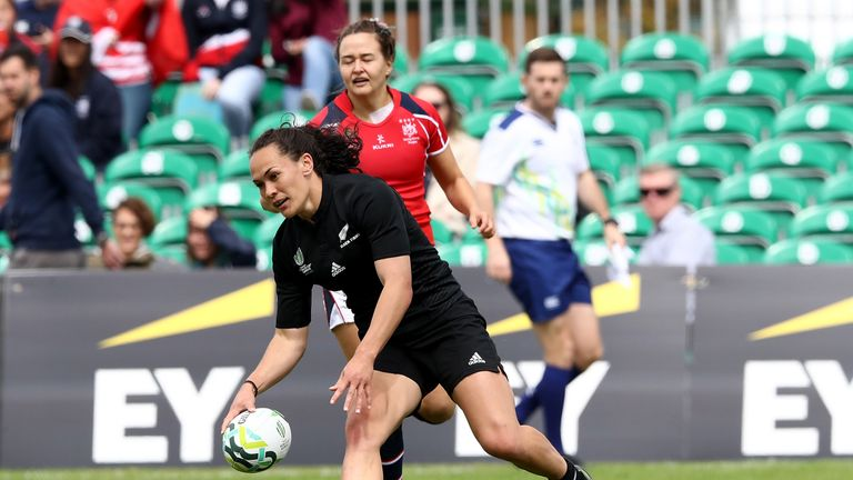 Portia Woodman breaks clear to score against Hong Kong