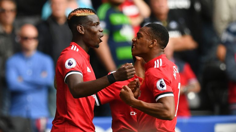 Anthony Martial celebrates scoring Manchester United's fourth with Paul Pogba