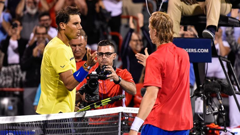 Rafael Nadal congratulates Canada's Denis Shapovalov after his shock defeat at the Montreal Masters