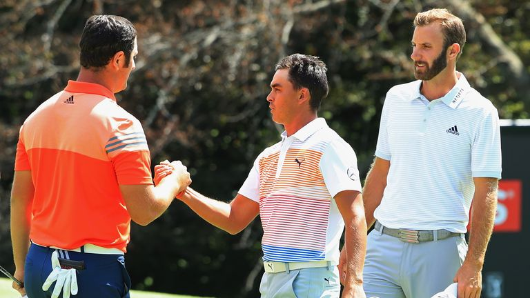 Jon Rahm (L) partnered Fowler and Johnson for the opening two rounds