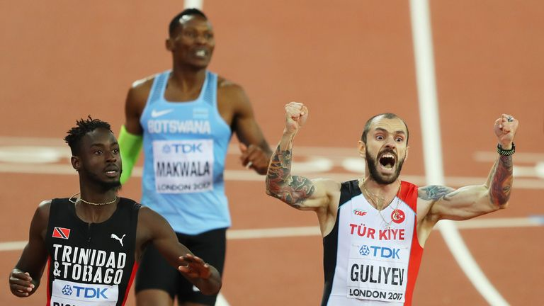 Ramil Guliyev celebrates as he crosses the line to win the men's 200m final