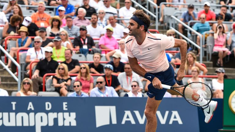 Roger Federer was taken to three sets by David Ferrer but came through