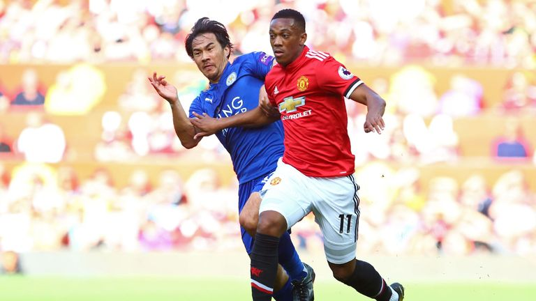 Shinji Okazaki and Anthony Martial tangle during the Old Trafford match