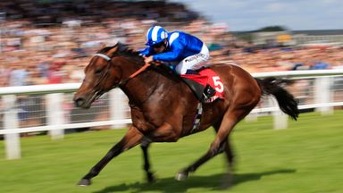 Massaat on the way to winning the Betfred Hungerford Stakes