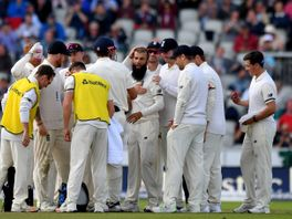 Moeen Ali is congratulated following a successful review for the wicket of Hashim Amla