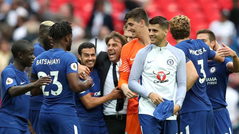 Antonio Conte, manager of Chelsea, celebrates victory with his players after the Premier League win over Tottenham Hotspur at Wembley
