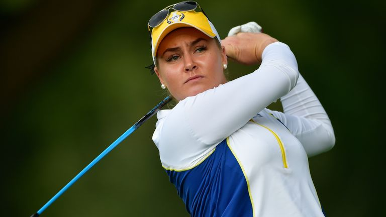 Charley Hull of Team Europe plays a shot during the morning foursomes matches of the Solheim Cup