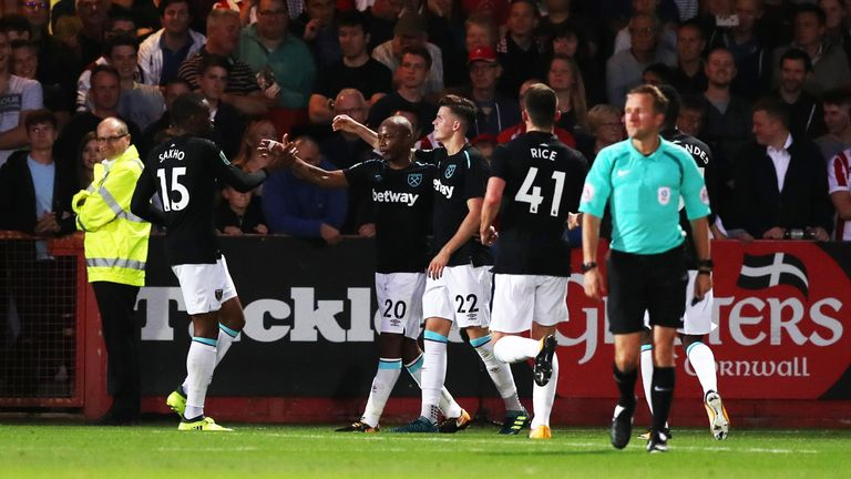 Andre Ayew (second left) celebrates with his West Ham team-mates after he scores their side's second goal of the game during the Carabao Cup, Second Round