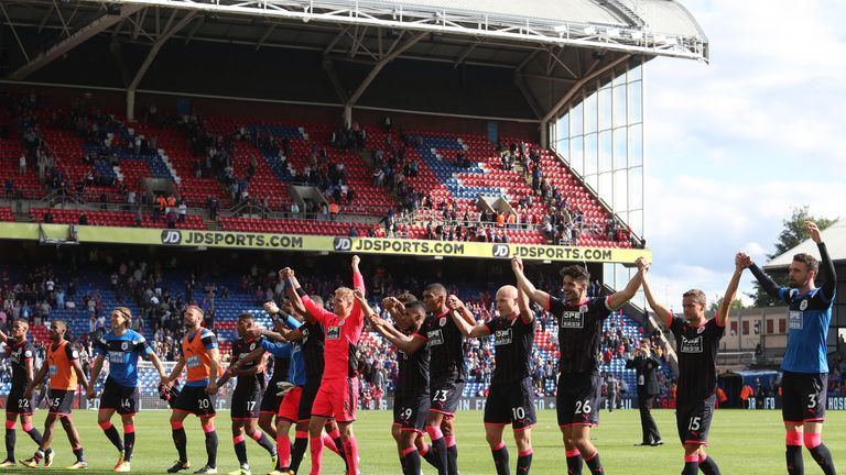 LONDON, ENGLAND - AUGUST 12: The Huddersield Town team celebrate victory after the Premier League match between Crystal Palace and Huddersfield Town at Sel