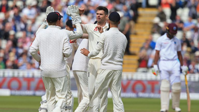 James Anderson (C) celebrates with team-mates after taking the wicket of Kyle Hope