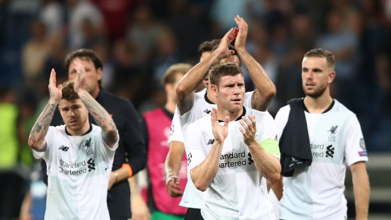 James Milner and team celebrate after the final whistle during the UEFA Champions League Qualifying Play-Offs Round First Leg match between 1899 Hoffenheim