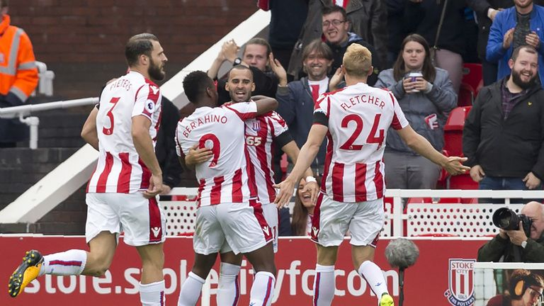 Stoke City striker Jese (C) celebrates with team-mates after scoring the opening goal of the Premier League football match v Arsenal
