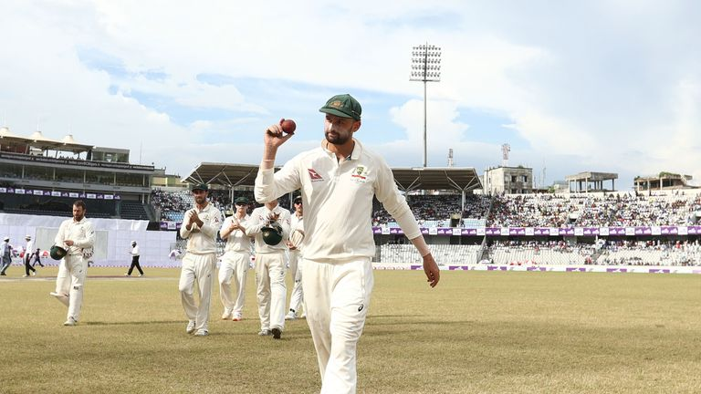 MIRPUR, BANGLADESH - AUGUST 29: Nathan Lyon of Australia holds up the ball after taking five wickets in the innings during day three of the First Test matc