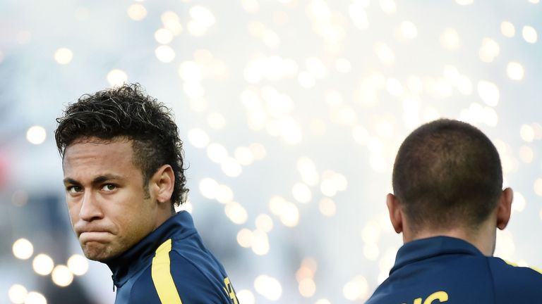 Neymar walks to the pitch prior to the Ligue 1 match against Guingamp