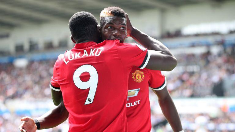 Paul Pogba celebrates a third goal with team-mate Romelu Lukaku