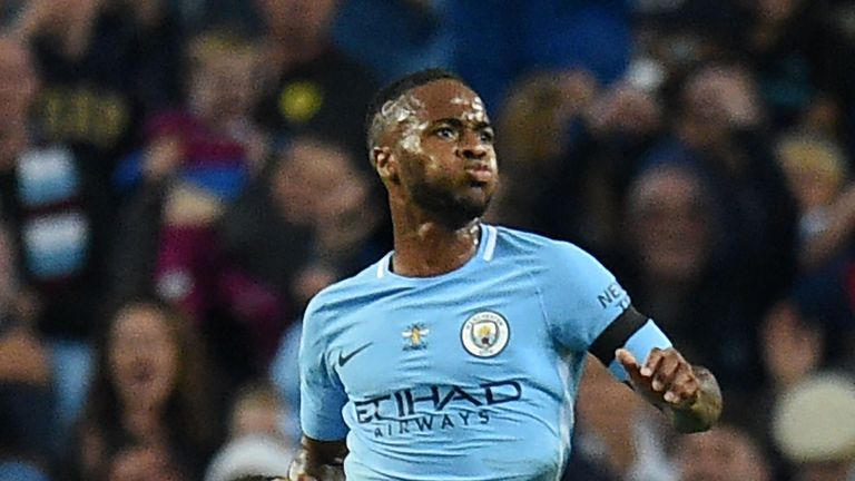 Raheem Sterling celebrates his second half equaliser against Everton
