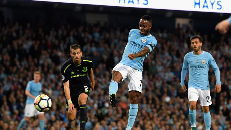 MANCHESTER, ENGLAND - AUGUST 21:  Raheem Sterling of Manchester City scores his sides first goal  during the Premier League match between Manchester City a