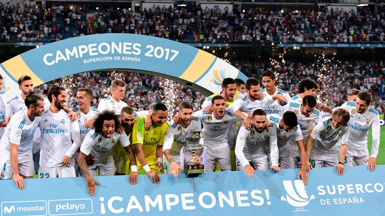 Real Madrid players celebrate their Supercup trophy after winning the second leg of the Spanish Supercup football match Real Madrid vs FC Barcelona at the