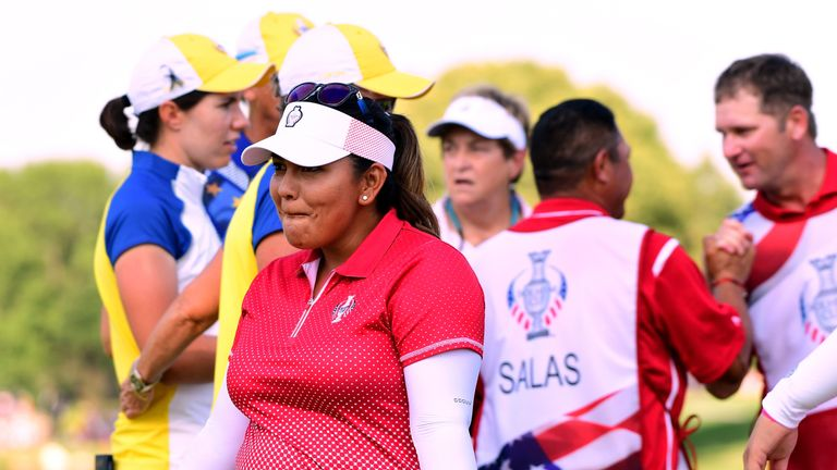 Lizette Salas of Team USA dances in celebration of a six and five win over Team Europe during the afternoon four-ball match at the Solheim Cup