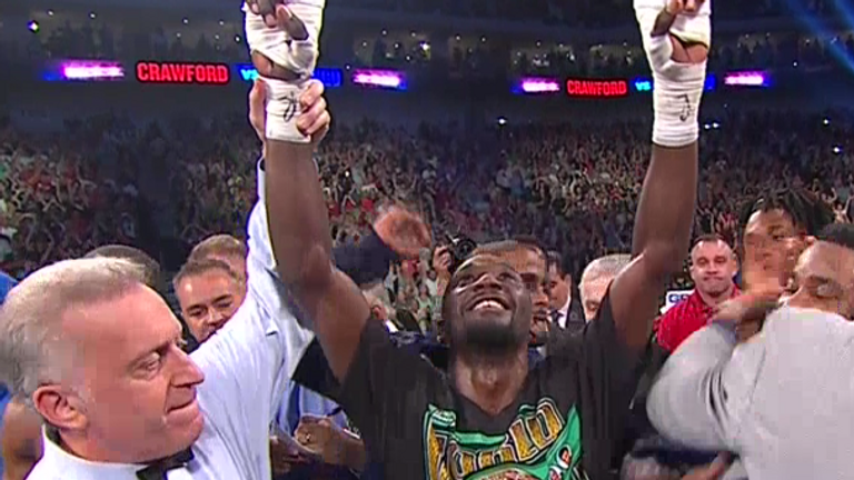Terence Crawford celebrates after becoming the undisputed champion