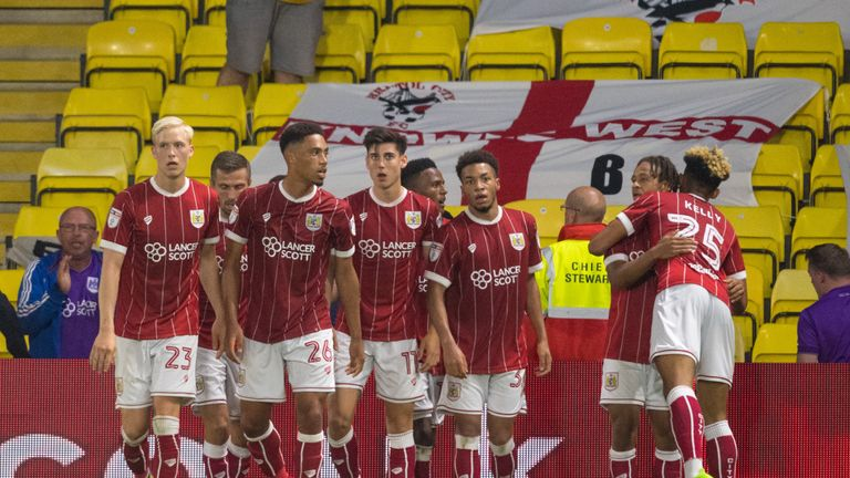 Bristol City's Bobby Reid (second right) celebrates scoring his side's second goal during the Carabao Cup, Second Round match at Vicarage Road, Watford