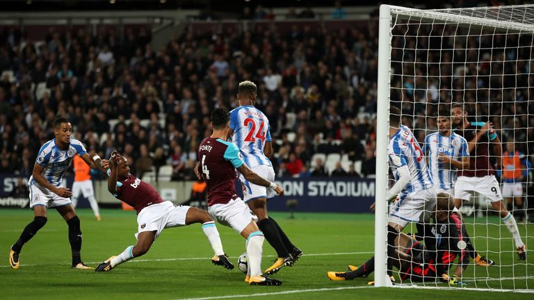 Andre Ayew pokes in West Ham's second after Huddersfield fail to clear Jose Fonte's header