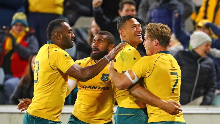Israel Folau is congratulated by his team-mates after scoring Australia's first try