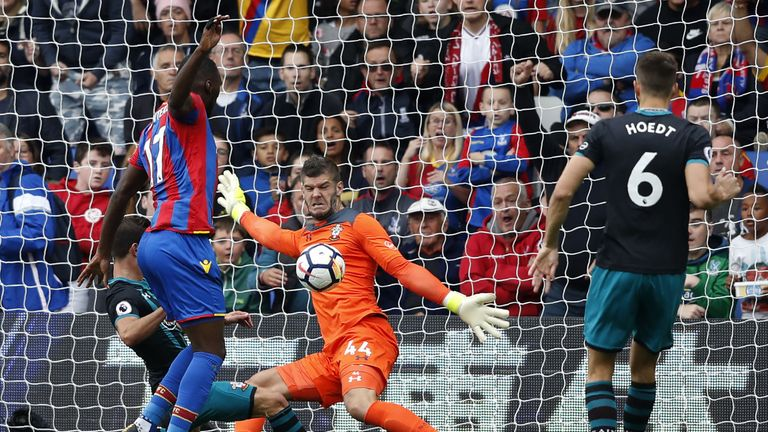 Southampton goalkeeper Fraser Forster (2R) saves a shot from Crystal Palace's striker Christian Benteke (2L)