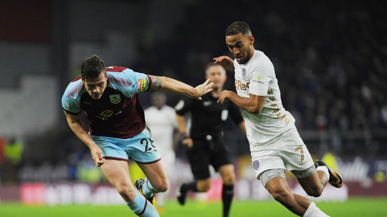 Kemar Roofe of Leeds and Kevin Long of Burnley challenge for possession