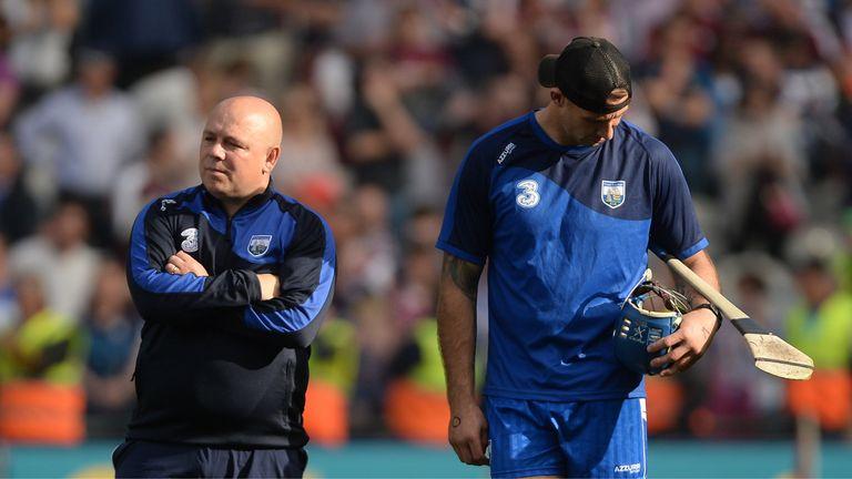 Waterford manager Derek McGrath, left, and selector Dan Shanahan dejected after the final.
