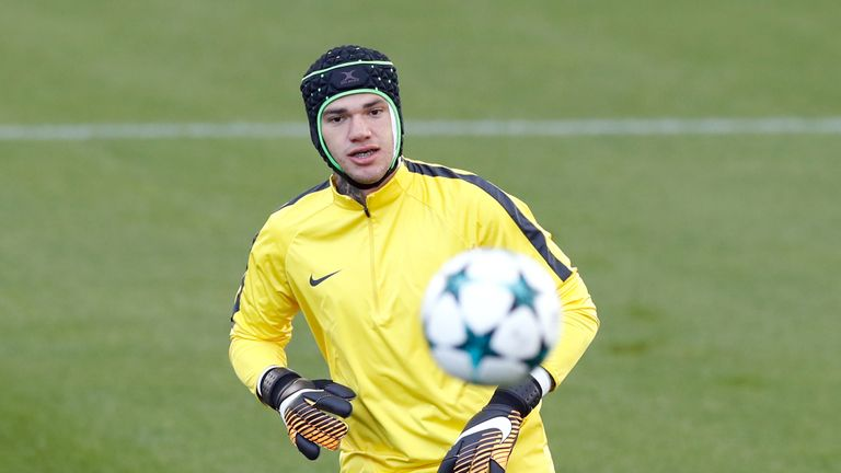 Ederson wore protective head gear in training