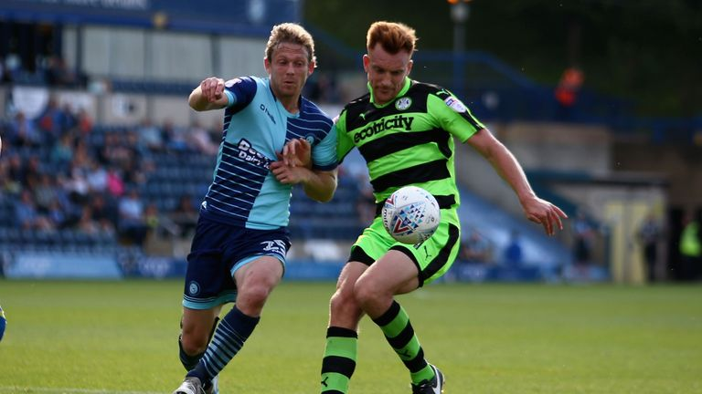 Craig Mackail-Smith of Wycombe Wanderers and Mark Roberts of Forest Green Rovers battle for possession