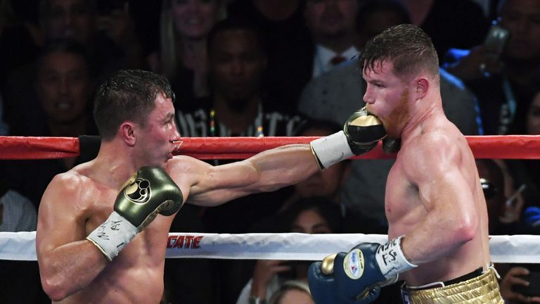 Gennady Golovkin (left) throws a left at Saul 'Canelo' Alvarez